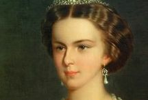 EMPRESS SISSI / Elisabeth of Austria (24 December 1837 – 10 September 1898) was the wife of Emperor Franz Joseph I, and thus Empress of Austria and Queen of Hungary. Born into Bavarian royalty, She enjoyed an informal upbringing, before marrying Franz Joseph at 16. exceptionally beautiful and high-spirited Sissy became a fairy-tale princess living in a gilded cage. As Empress of Austria Sissi was expected to behave at all times in a regal manner, but her rural childhood had not prepared her for court life.  / by Daisy A Castellanos