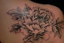 Tattoos / by Samantha Darnell