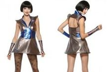 Sectorian Fashion Inspiration / Sub-board for inspirations for my sci fi webcomic, Simulacrum. This one is for the fashion of the Sectorian Colonies. The Sectorian Colonies are a federation of eight human colonies established in various star systems. Their fashion is inspired by atompunk, retro futurism (60s, 70s, 80s), cyber/pastel goth, spacepunk, and futuristic styles in general. It is similar to Corporation fashion, but is more varied. / by Hannah Bottenberg
