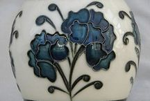 Moorcroft Pottery /  In 1897 Staffordshire pottery manufacturers James Macintyre & Co. Ltd employed 24-year-old William Moorcroft as a designer, and within a year he was put in full charge of the company's art pottery studio. They later parted ways and William started his own company,  Moorcroft Pottery  / by Betty D