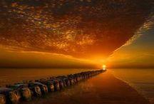 Sunrises and Sunsets / by Ellen van der Molen