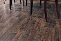 Laminate Flooring / Laminate flooring planks are made of a few, basic layers. The bulk of the plank is called the core layer. The bottom layer of laminate is a stabilizing layer, and the top two layers are the photograph that displays the particular look you are after, and a transparent finishing layer on top of that, which protects the laminate from scratches, stains and moisture. / by FloorsToYourHome (.com)