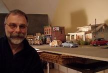The Town That Time Forgot / These photos are not so ordinary as it might appear at first glance. The fact is that each and every shot is a part of a miniature world carefully constructed and photographed by the amazing artist Michael Paul Smith...  And now a giant grabs the Studebaker.... / by Jerry Panza