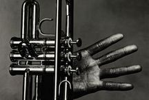 Jazz  / Jazz is a music that originated at the beginning of the 20th century, arguably earlier, within the African-American communities of the Southern United States. Its roots lie in the adoption by African-Americans of European harmony and form, taking on those European elements and combining them into their existing African-based music. Its African musical basis is evident in its use of blue notes, improvisation, polyrhythms, syncopation and the swung note. / by Edward Alshut AIA