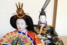 Hina Ningyō 雛人形 / Ornamental Japanese dolls representing the Emperor, Empress, attendants, and musicians in traditional court dress of the Heian period, displayed on red-carpeted shelves every year on March 3 for Hinamatsuri 雛祭り(Girl's Day or Doll's Day). / by LauraH