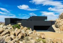 Black houses / by Dezeen magazine