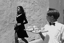 """FERDINANDO SCIANNA / """"A photograph is not created by a photographer. What they does is just to open a little window and capture it. The world then writes itself on the film. The act of the photographer is closer to reading than it is to writing. They are the readers of the world. """" / by a lady with a cat"""