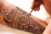 HENNA TATTOOS / by Emily Briggs