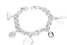~Charming Charm Bracelets~ / by Tasha Rollins Arrington