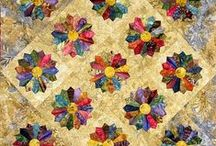 QUILTS AND QUILTING / Blocks of a material sewn together into a bed cover.  Quilting frames and ideas from several web sites. / by Karen Taylor