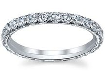 Eternity Bands / Our eternity bands and eternity rings are perfect to wear as a wedding band or be presented to your significant other on a wedding anniversary.  We offer an array of styles, carat weights, and diamond cuts.  We have single row pave rings, triple row pave rings, and more! / by deBebians