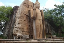 Avkana Buddha Statue, Sri Lanka / The Avukana statue is a standing statue of the Buddha near Kekirawa in North Central Sri Lanka. The statue, which has a height of more than 40 feet (12 m), has been carved out of a large granite rock face during the 5th century. It depicts a variation of the Abhaya mudra, and the closely worn robe is elaborately carved. Constructed during the reign of Dhatusena, it may have been made as a result of a competition between a master and a pupil. (from Wikipeida) / by Secret Lanka