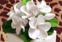 Gumpaste Plumerias / Ready made gumpaste Plumerias that make perfect decorations for any cake.  These are all handmade out of sugar.  Perfect for any buttercream or rolled fondant cake.  Edible. / by CaljavaOnline.com