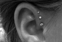piercings and earings / by Kathleen Michailuk