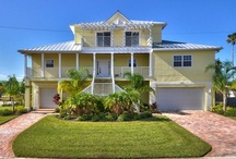 Madeira Beach 849 Bay Point Dr. Florida 33708 MLS# U7557603 / Move-in condition! Built in 2010 on the most prestigious street in Madeira Beach, this Beautiful Home has all the modern Bells & Whistles, plus the flavor and charm of a vintage Key West Plantation Home.  3 BEDROOMS plus a MEDIA ROOM and a BONUS ROOM, 3.5 BATHROOMS, tons of STORAGE SPACE and a  FIVE+ CAR GARAGE. Perfect for entertaining, very tasteful formal living and dining areas, plus an outstanding 768 Sq ft MEDIA/FAMILY room overlooking the water (can be used as a Master Bedroom). / by Jennie Blackburn