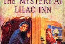 Nancy Drew: LILAC INN / Guiding the car into the side road, she drove beneath a long canopy of trees and presently came within sight of Lilac Inn. As she swung the roadster into line with the row of automobiles parked in the yard, it seemed to her that the old inn had never appeared more picturesque than on this particular spring day.  Huge lilac bushes, heavy with bloom, completely surrounded the rambling structure, while a well kept lawn sloped gently to a crystal lake at the rear... / by Janice Lawson