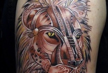 Lions / by Tattoos