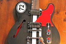 Guitars / by Logan Dumont