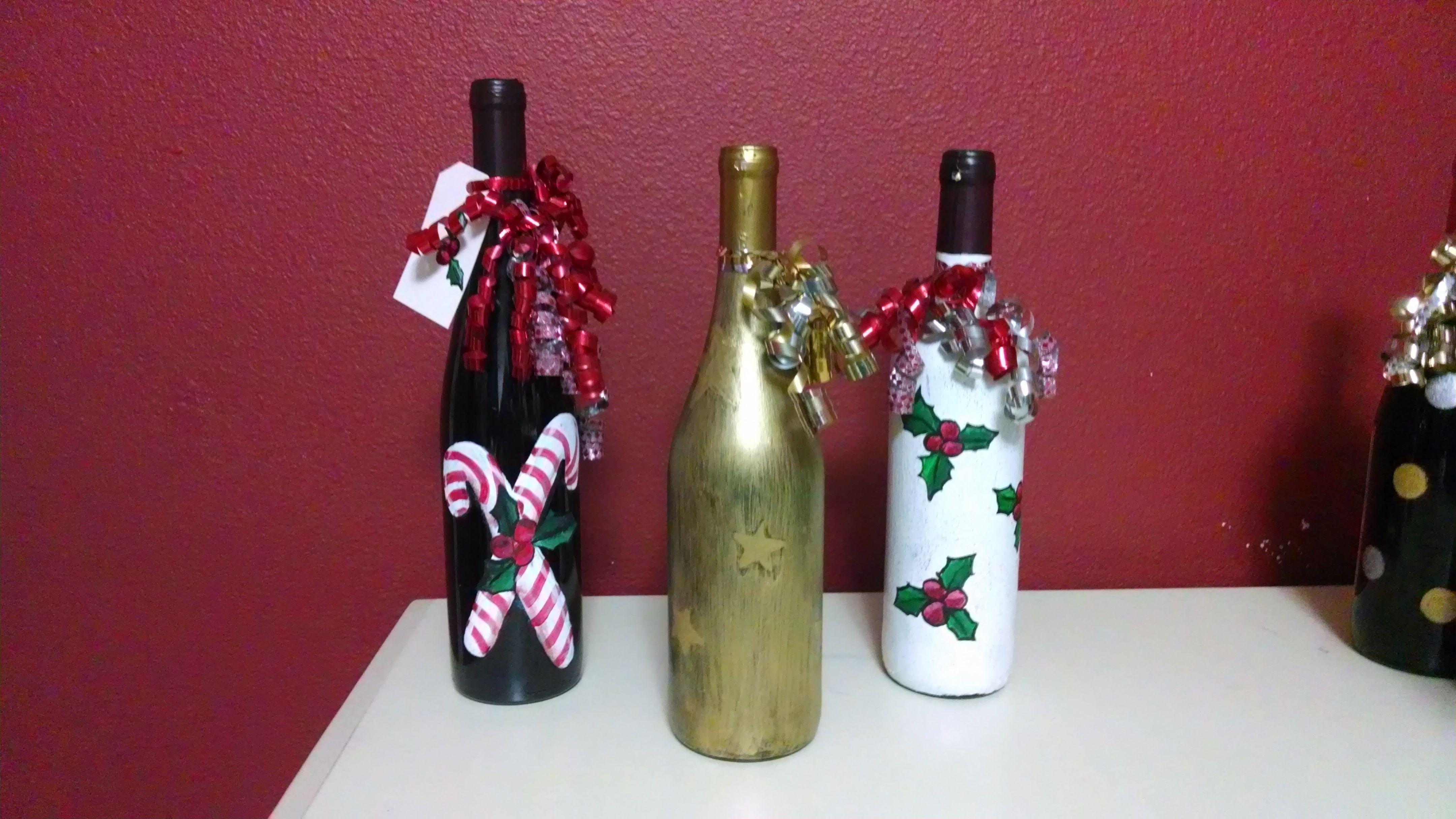 Painted christmas wine bottles wine bottle craft pinterest for Painted wine bottles