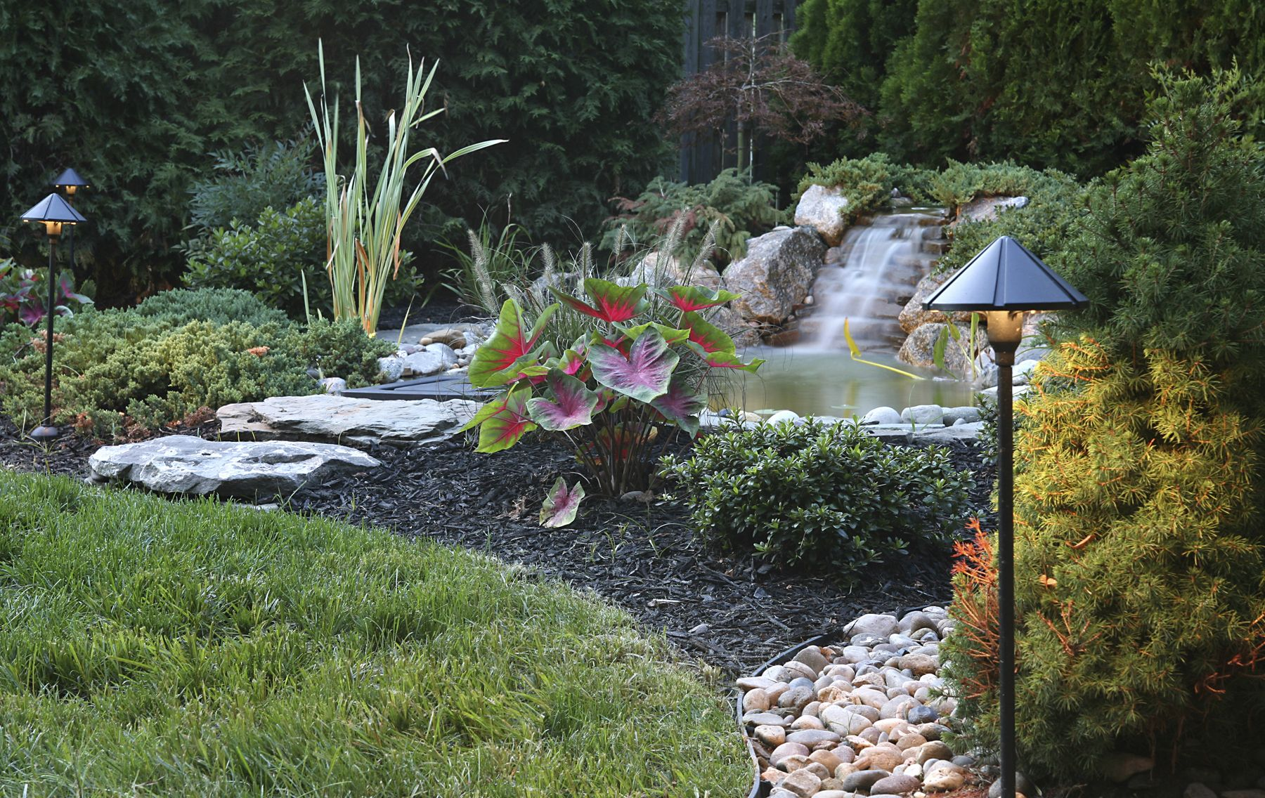 Beautiful Backyard Pond With A Waterfall Water Features