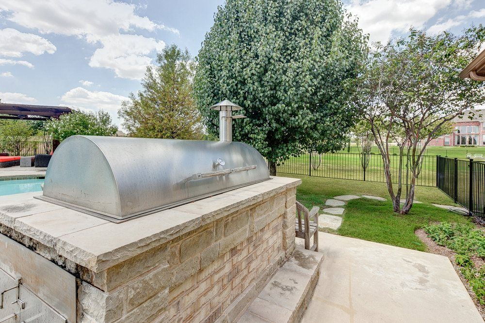 definitely need the built in smoker outdoor kitchens