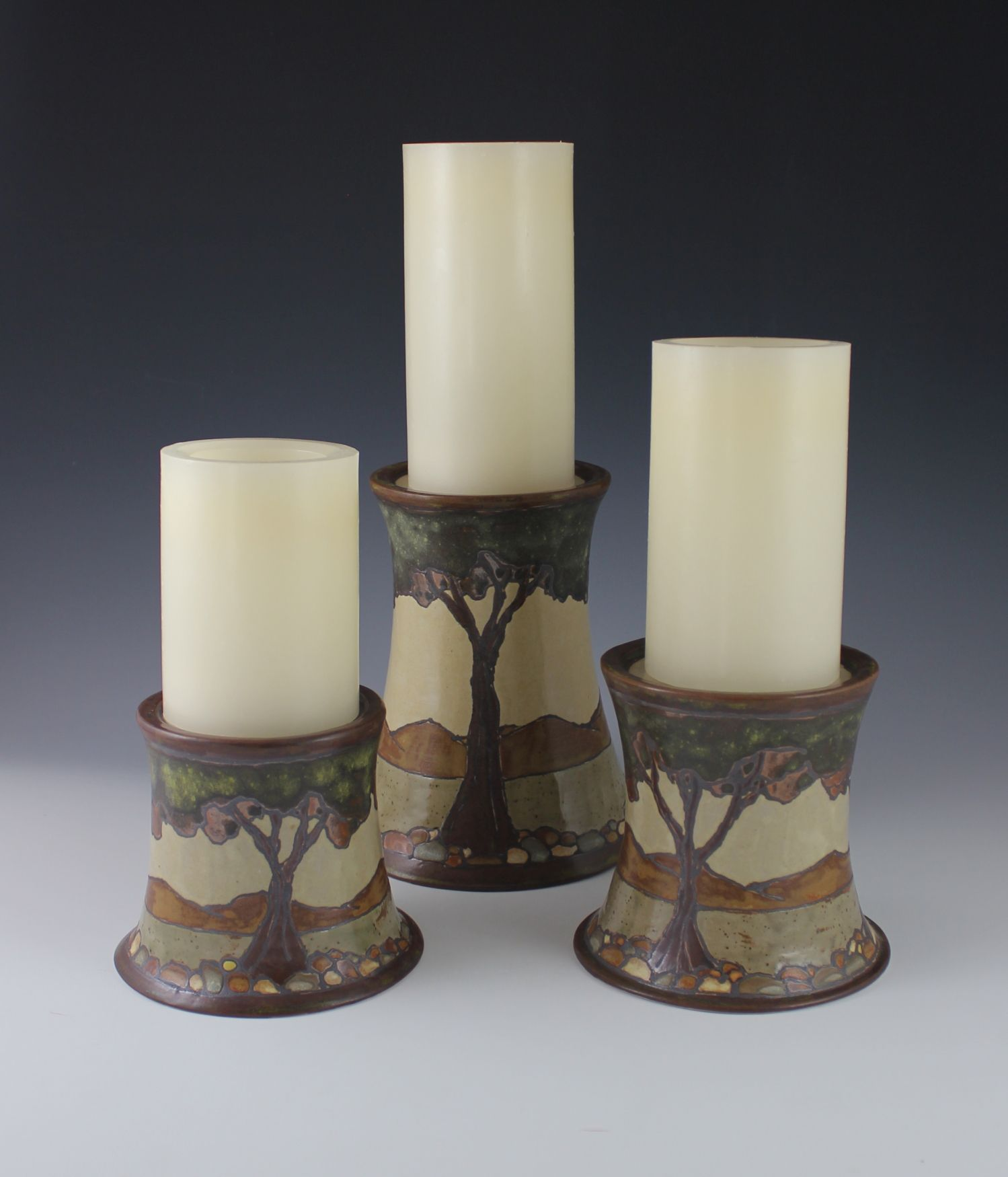 Pillar candle holders arts and crafts pottery pinterest for Arts and crafts candle sconces
