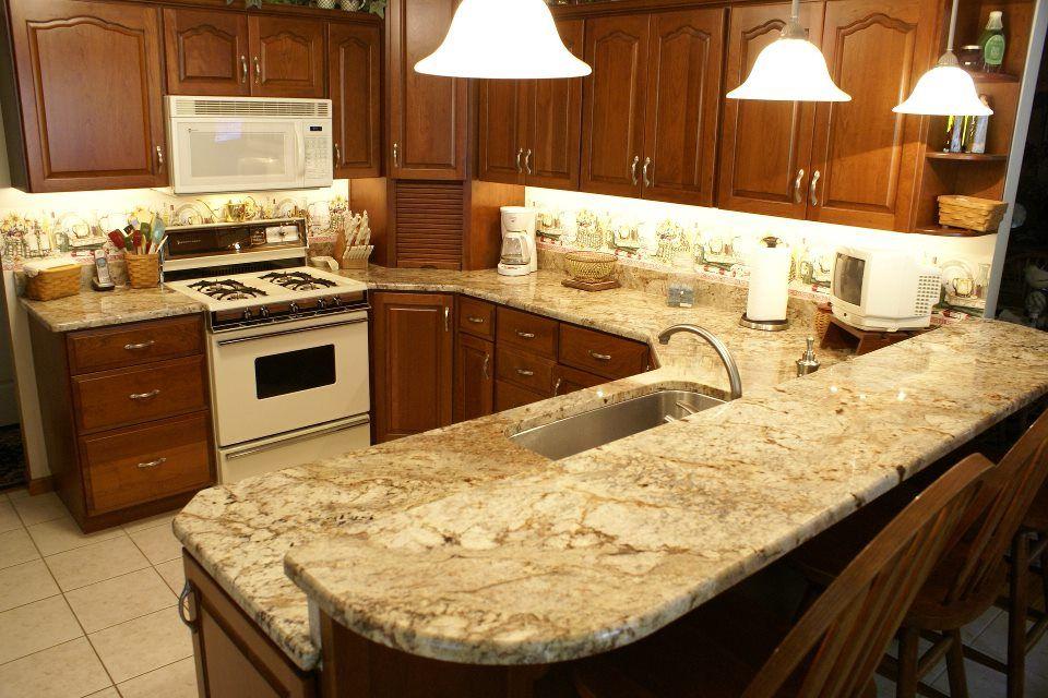 Kitchen in Sienna Bordeaux Granite  Granite with white cabinets  Pi