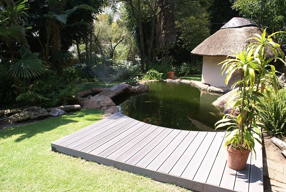 Koi pond deck done in xavia color garden gorgeous for Deck pond ideas