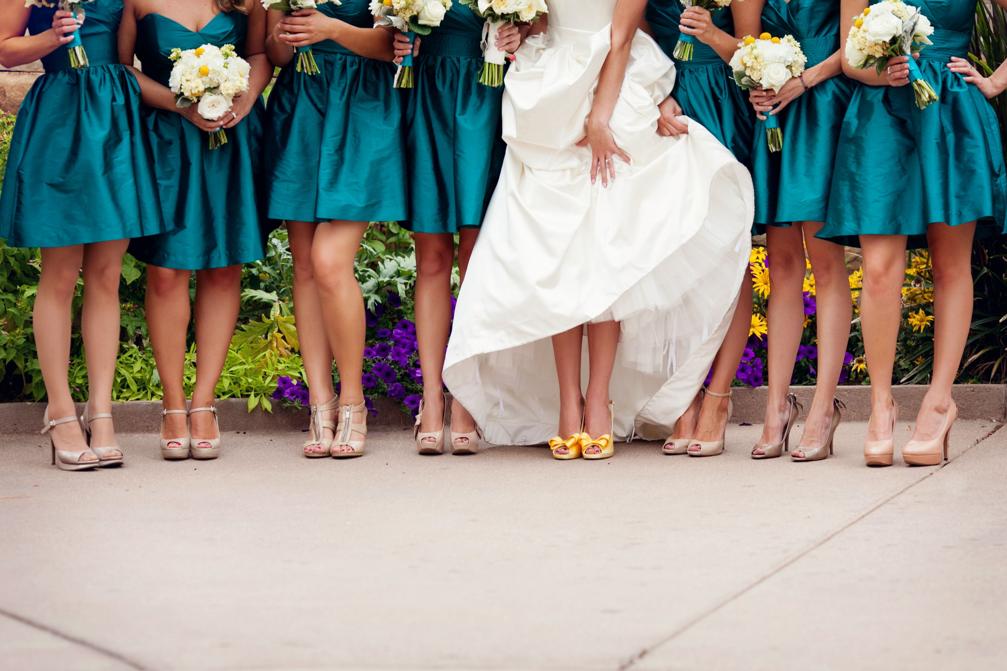 bride wearing yellow shoes with bridesmaids
