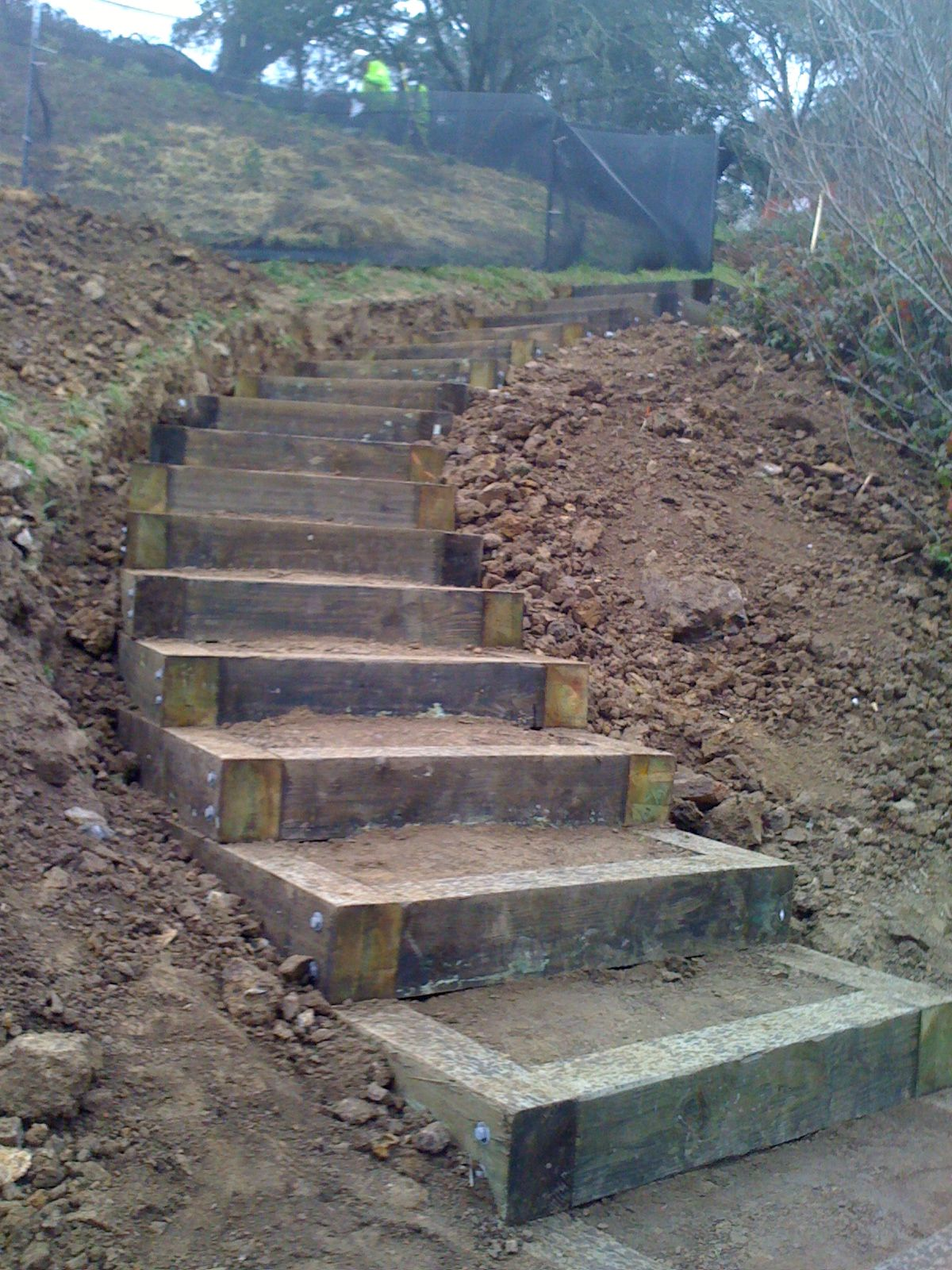 Stairs in hillside being landscaper pinterest for How to build a house on a steep slope