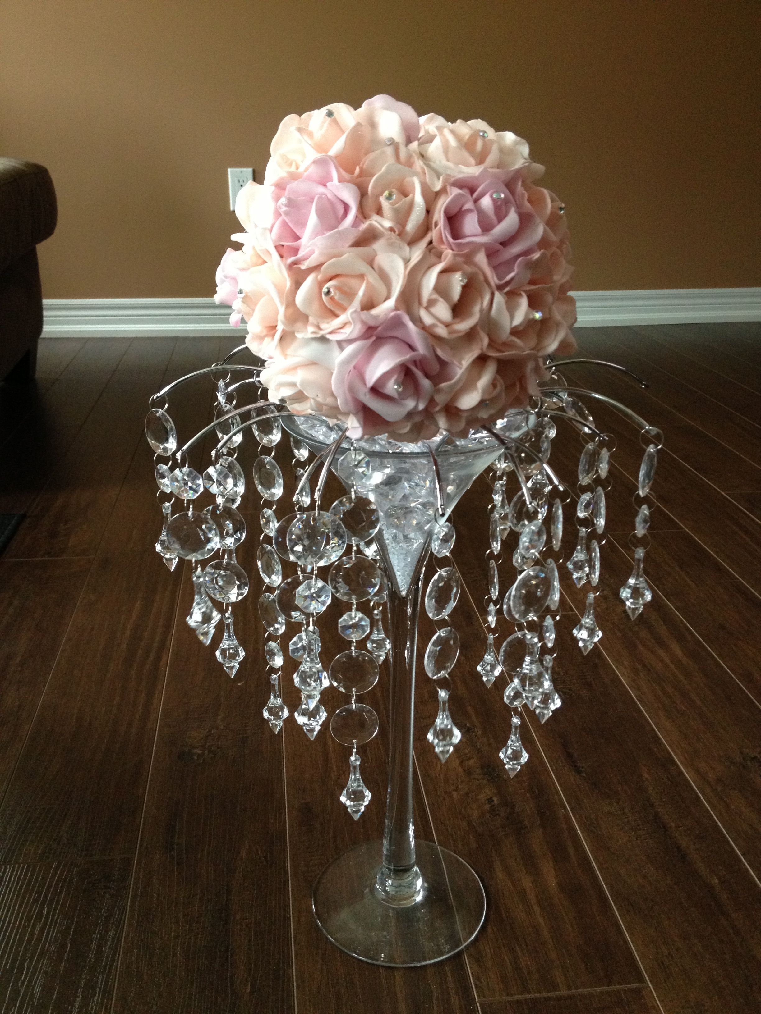 Pale peach and pink martini glass centerpiece with