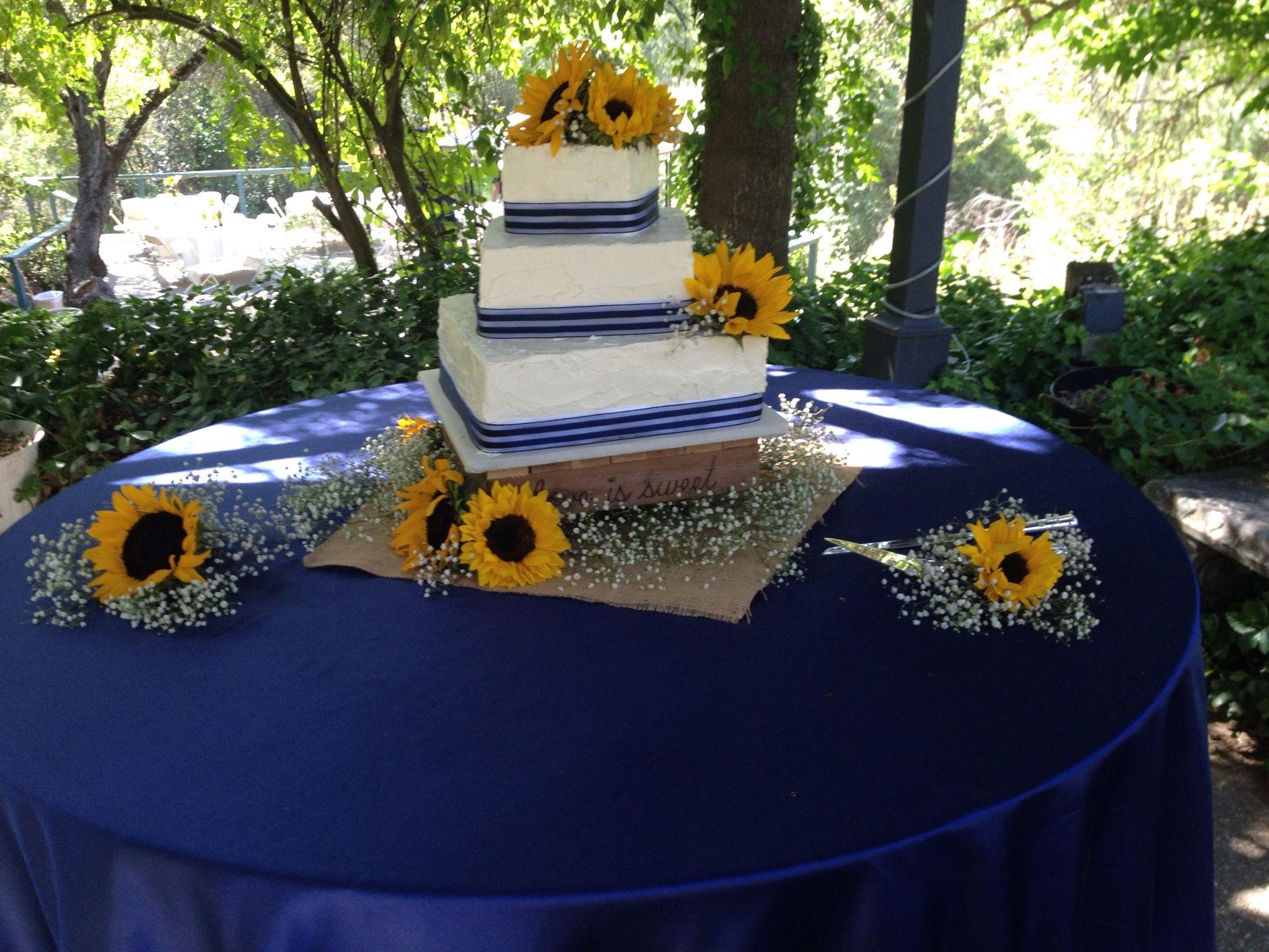 Sunflower and cobalt blue wedding cake