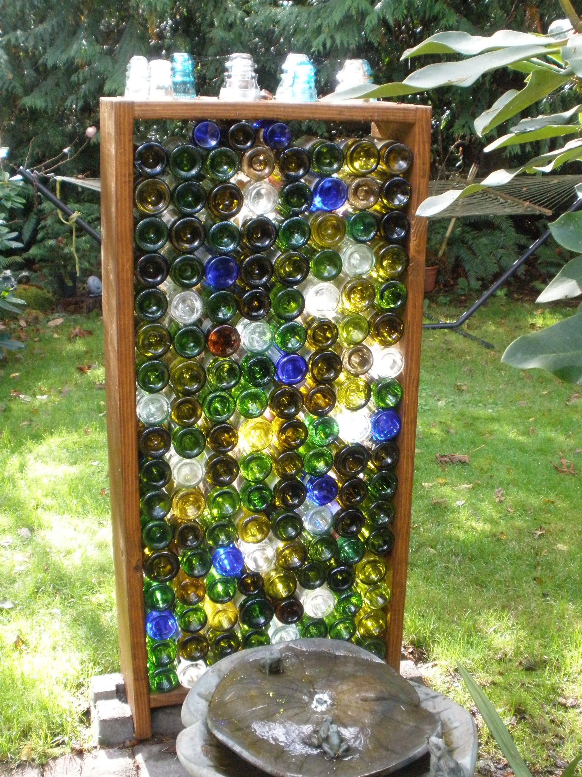 Glass wine bottle garden wall garden pinterest for How to build a bottle wall