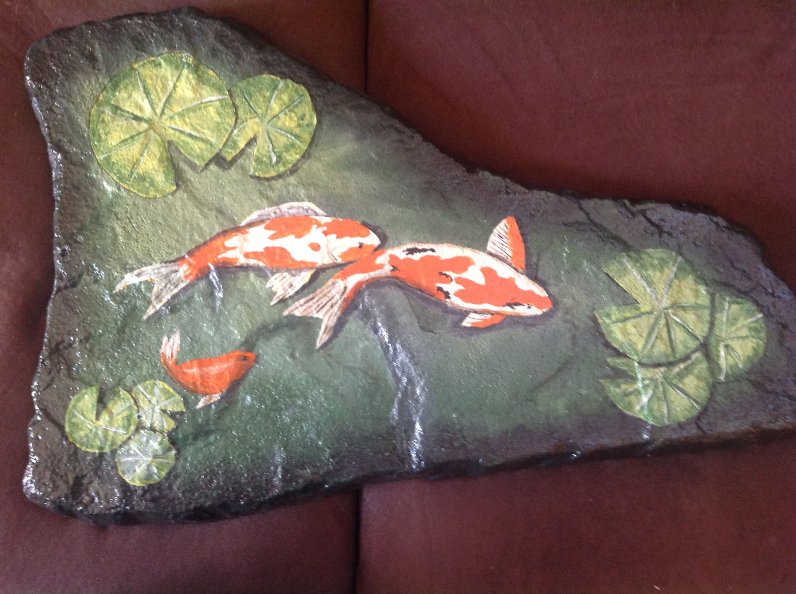 More painted koi ponds garden decoration painted for Fish pond rocks