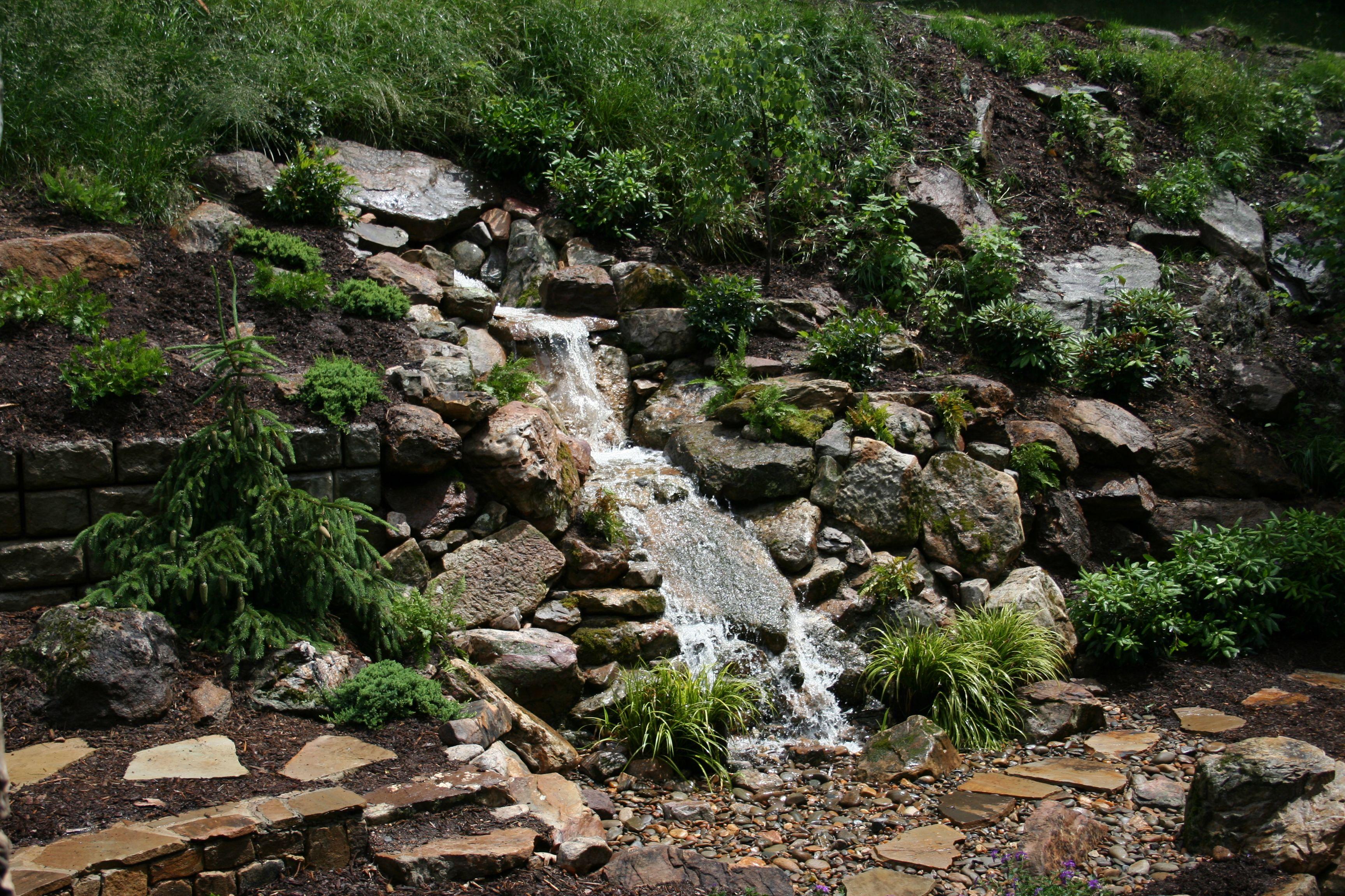 Pondless waterfall garden waterfalls pinterest for Pondless waterfall