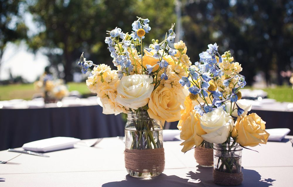 Blue and yellow centerpieces flowers everywhere