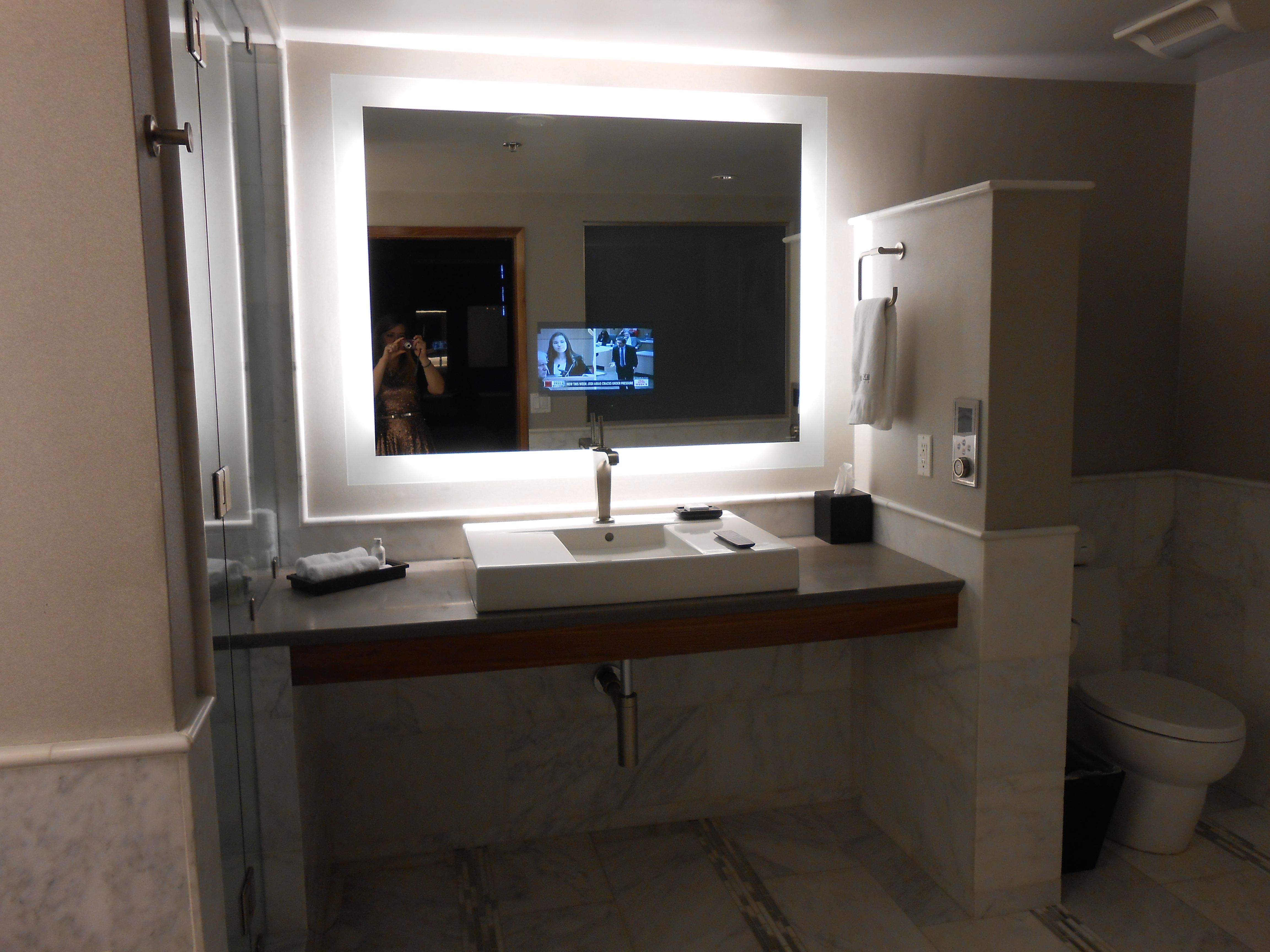 tv in the bathroom mirror house planning