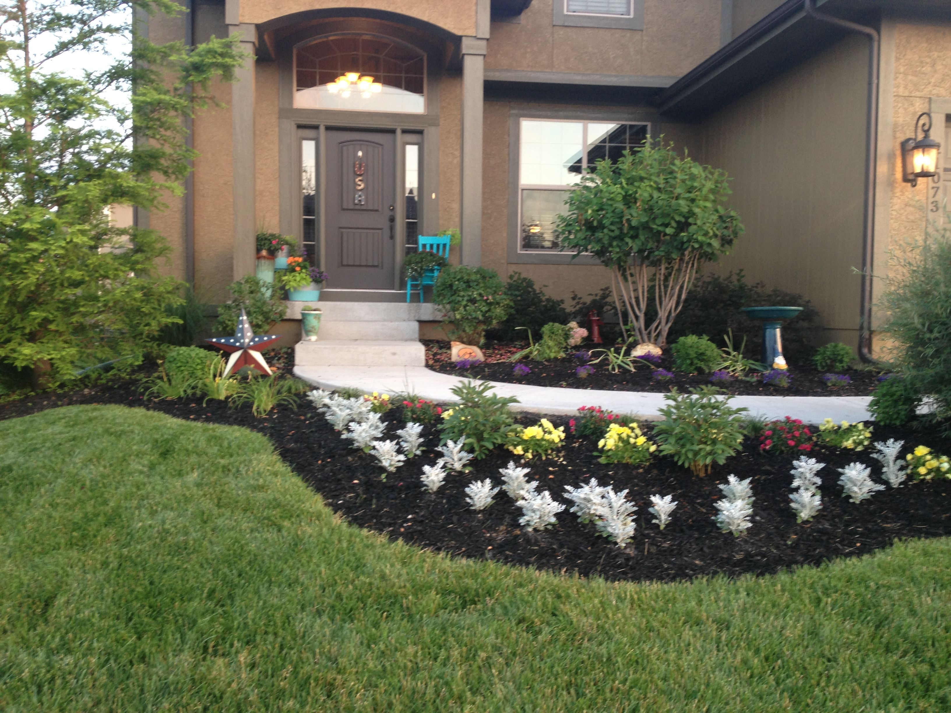Front flower beds concrete walkway ramp pinterest for Front flower bed landscaping