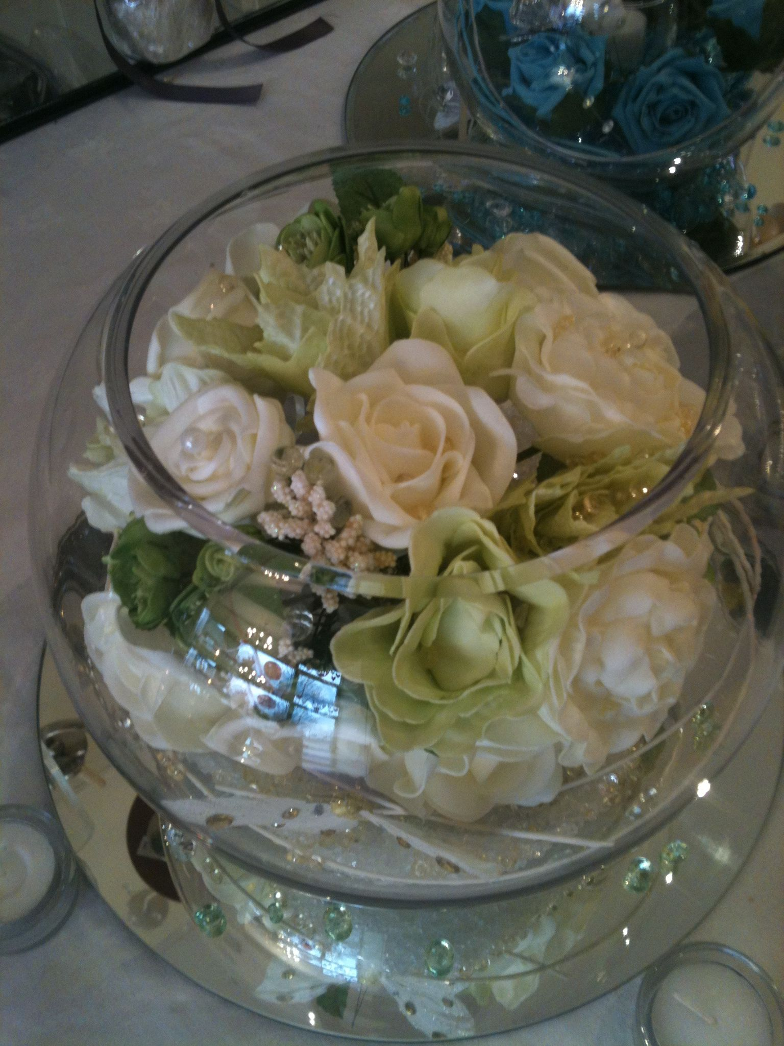 Large fish bowl with ivory roses wedding centrepieces for Large fish bowl
