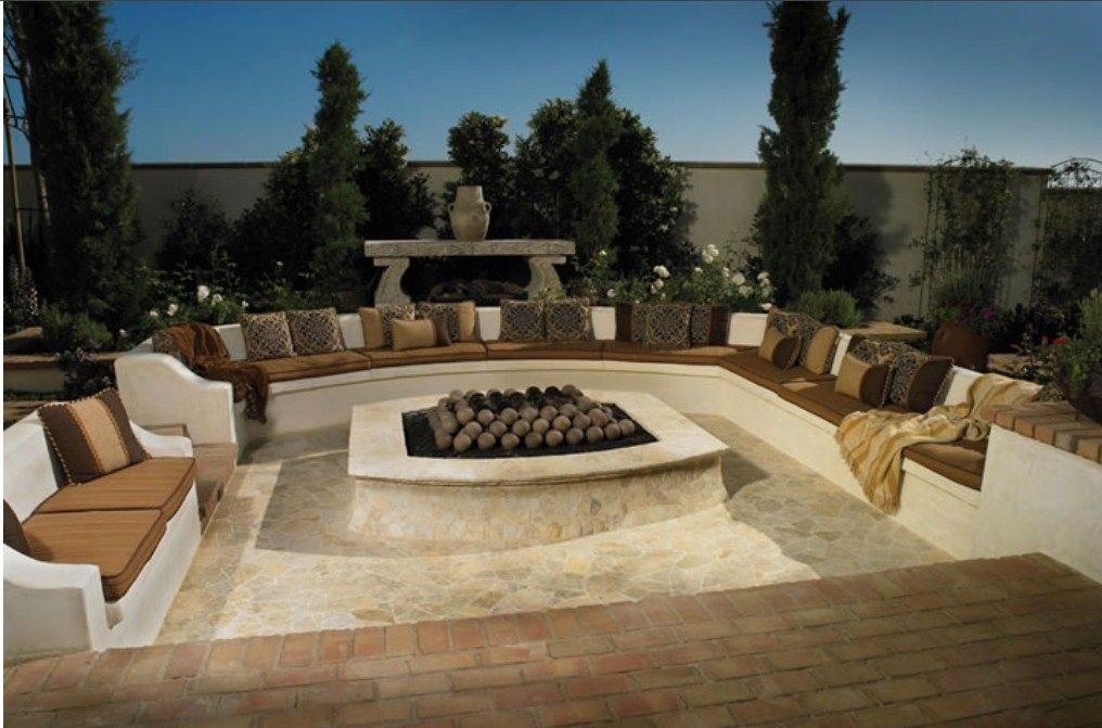 Cozy fire pit with area to lounge in outdoor living spaces pinte - Types fire pits cozy outdoor spaces ...