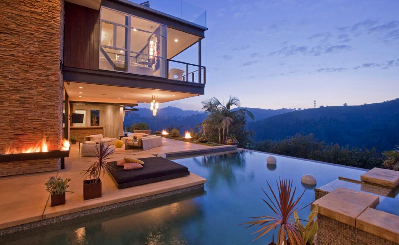 Home with infinity pool vacation homes resorts pinterest for Houses that have pools