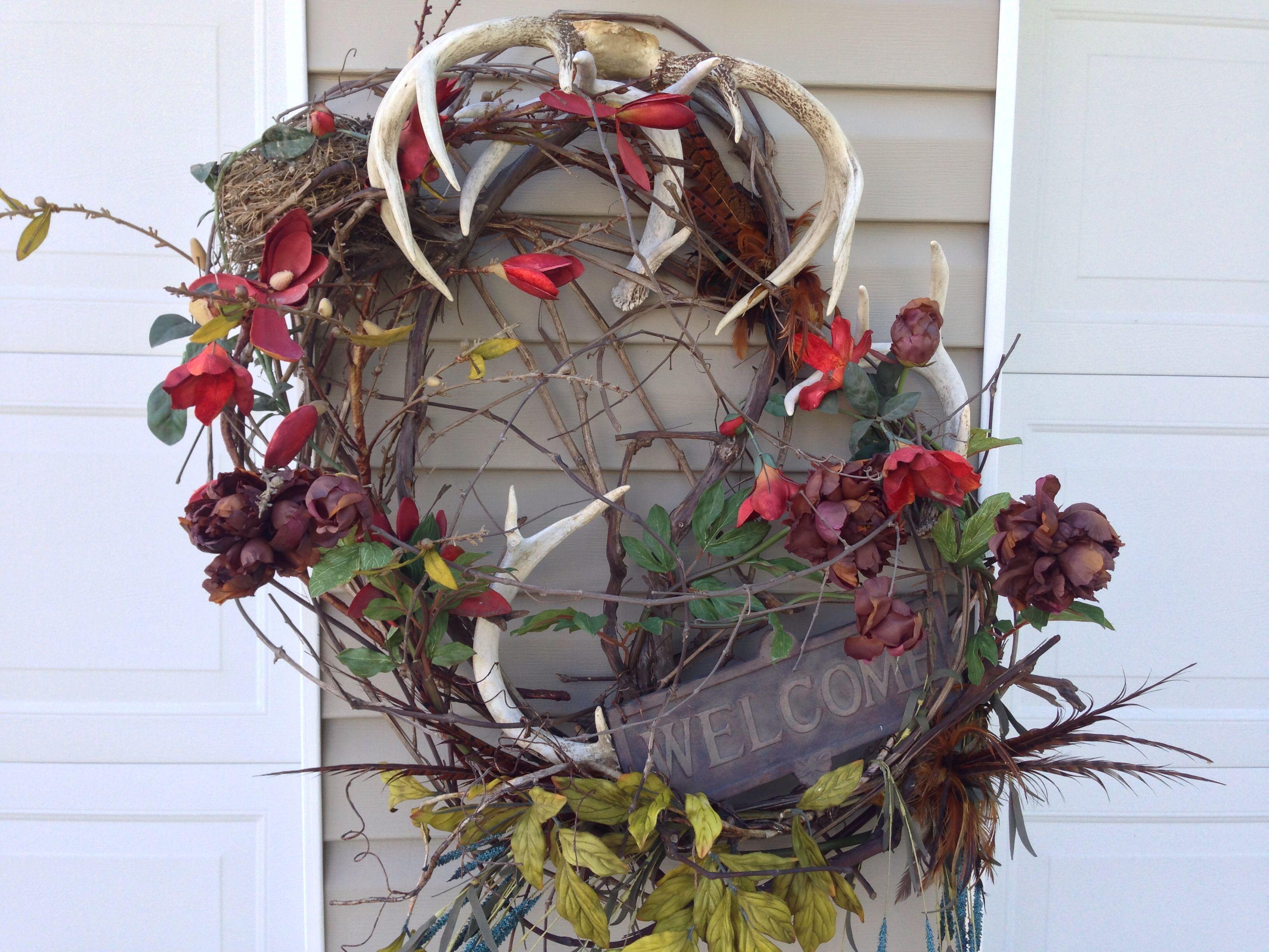 Deer antlers wreath wreaths pinterest for Antler christmas wreath
