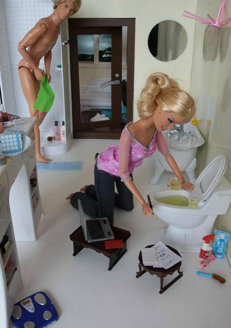 Barbie and ken in bathroom