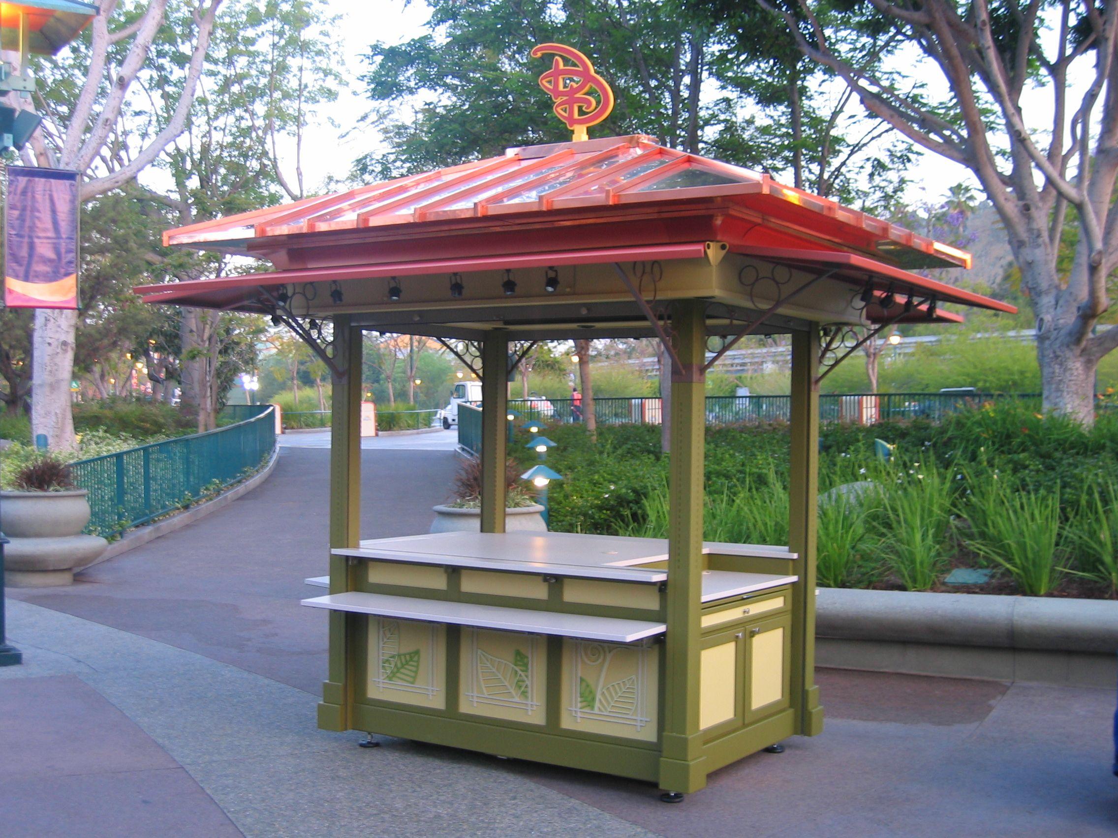 Outdoor kiosk downtown disney kiosk style pinterest for Garden kiosk designs