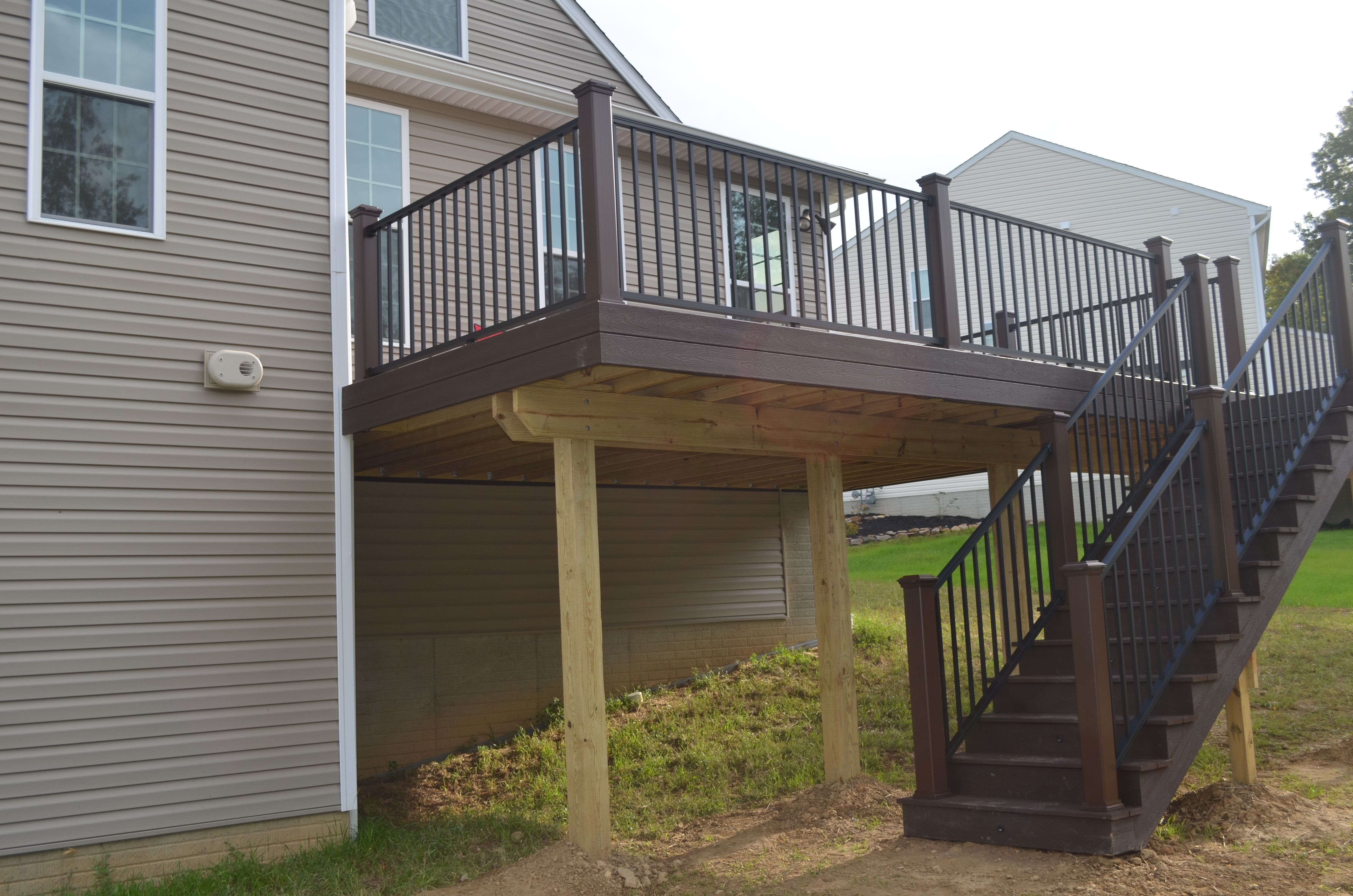 Low maintenance deck second story low maintenance for Second story deck designs