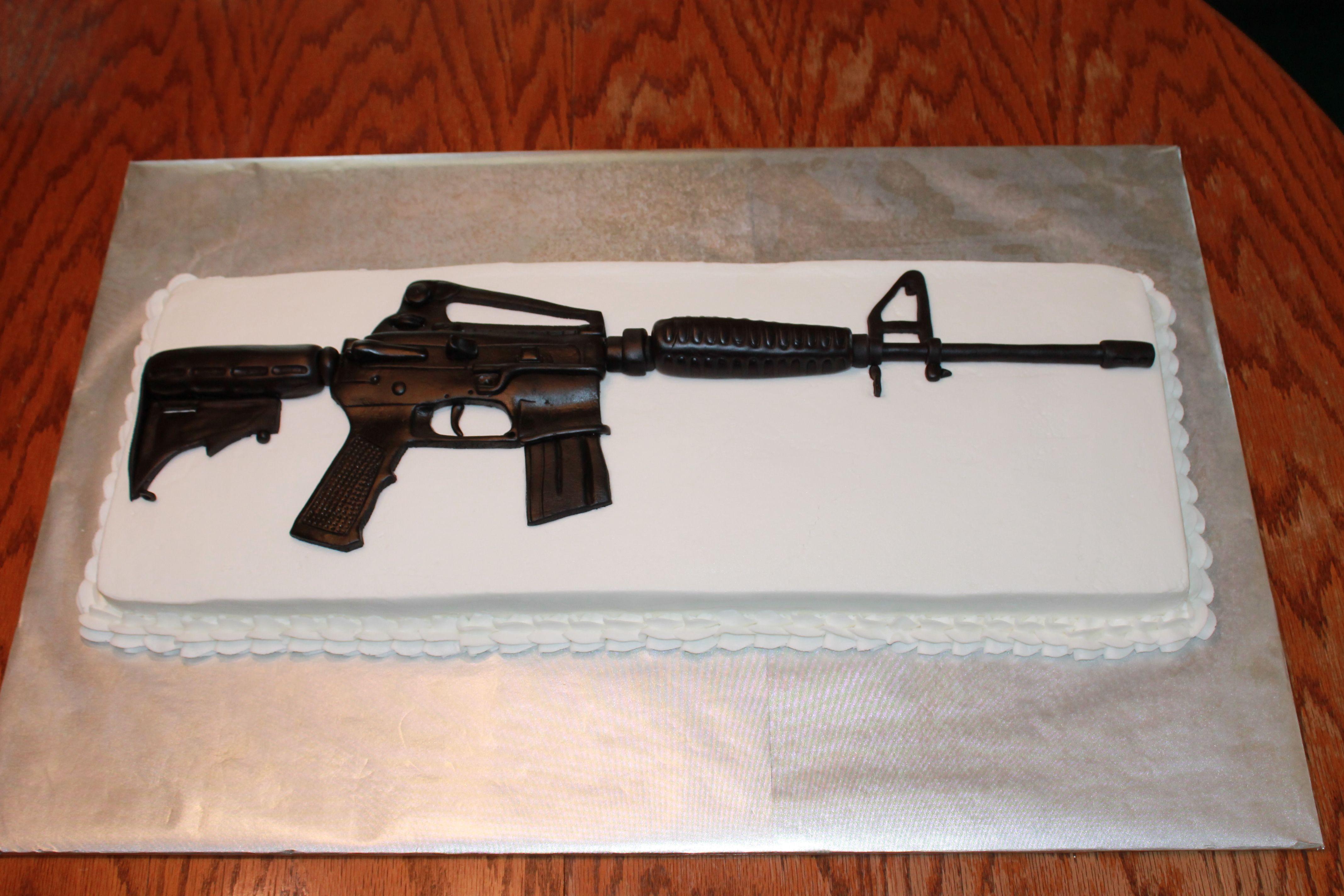 gun shaped birthday cakes