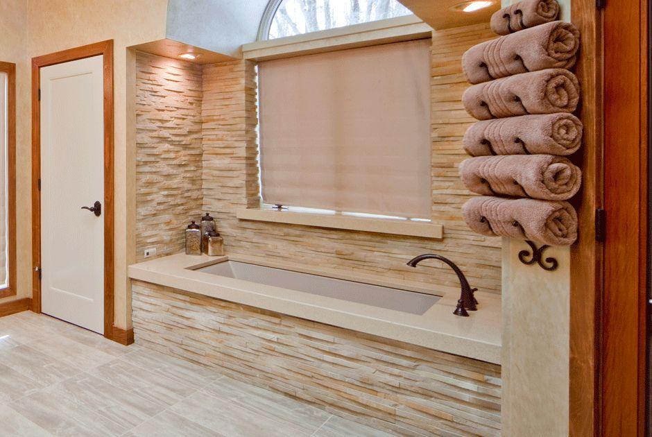 Stacked stone walls above tub bathroom building ideas for Stacked stone bathroom ideas