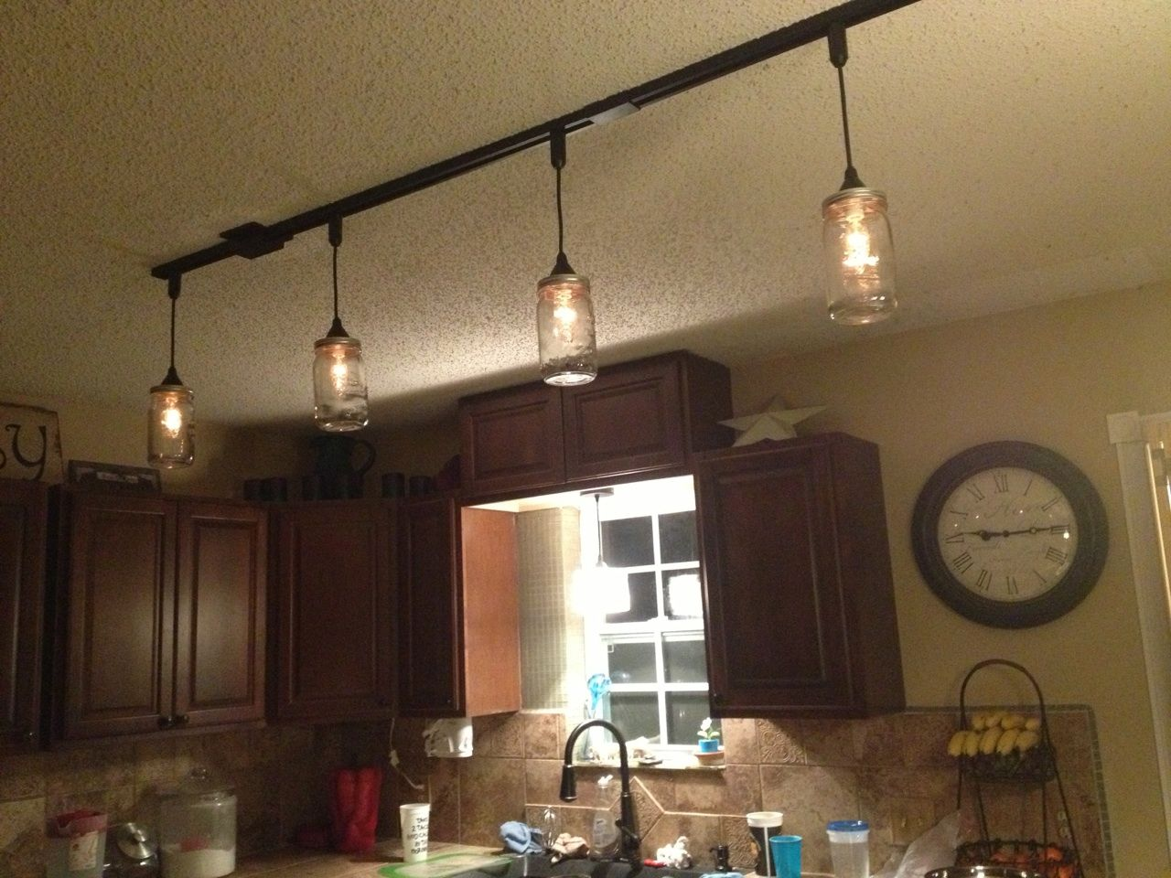Mason jar kitchen lights diy craft projects pinterest for Mason jar kitchen ideas