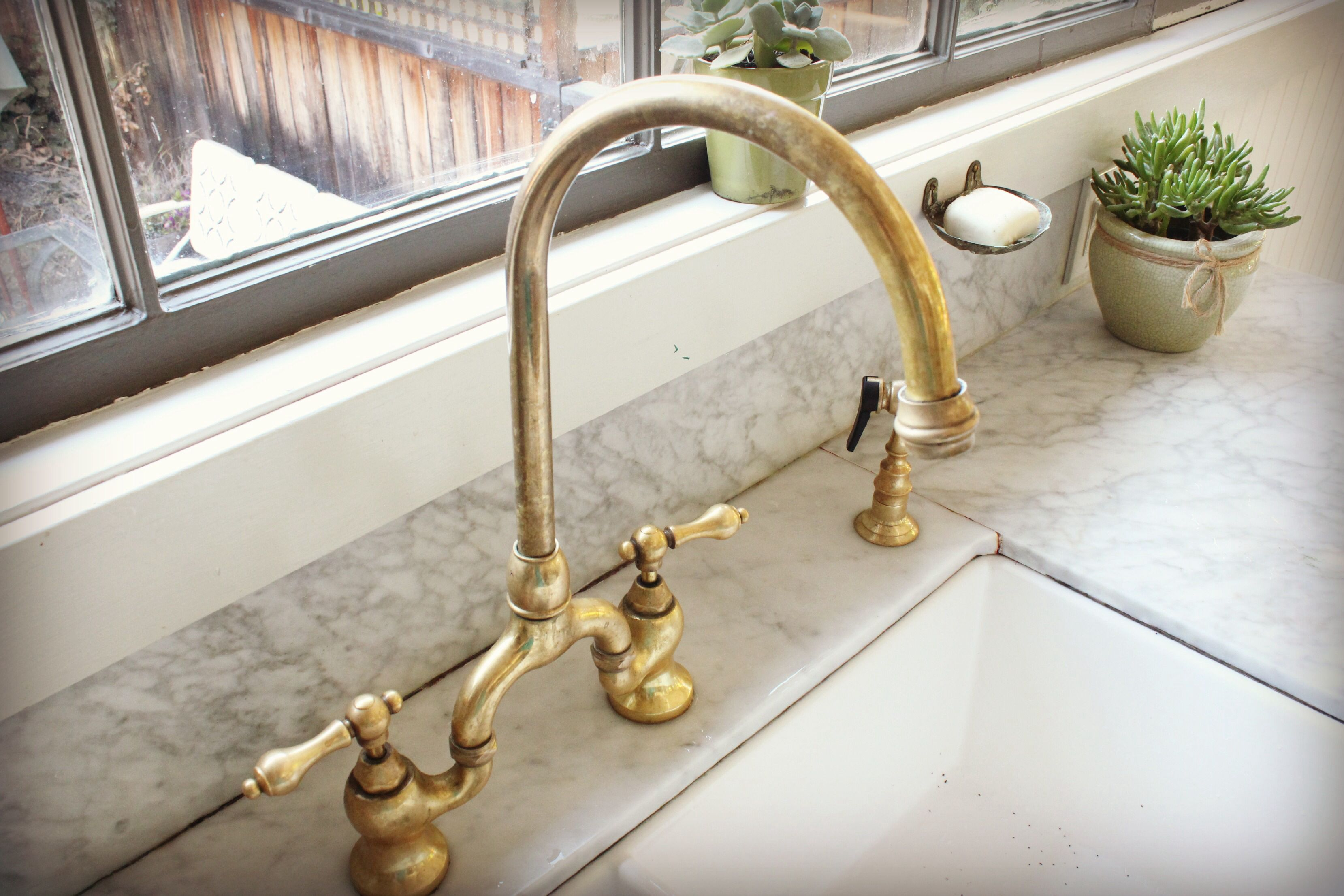 Unlacquered brass bridge faucet House ideas
