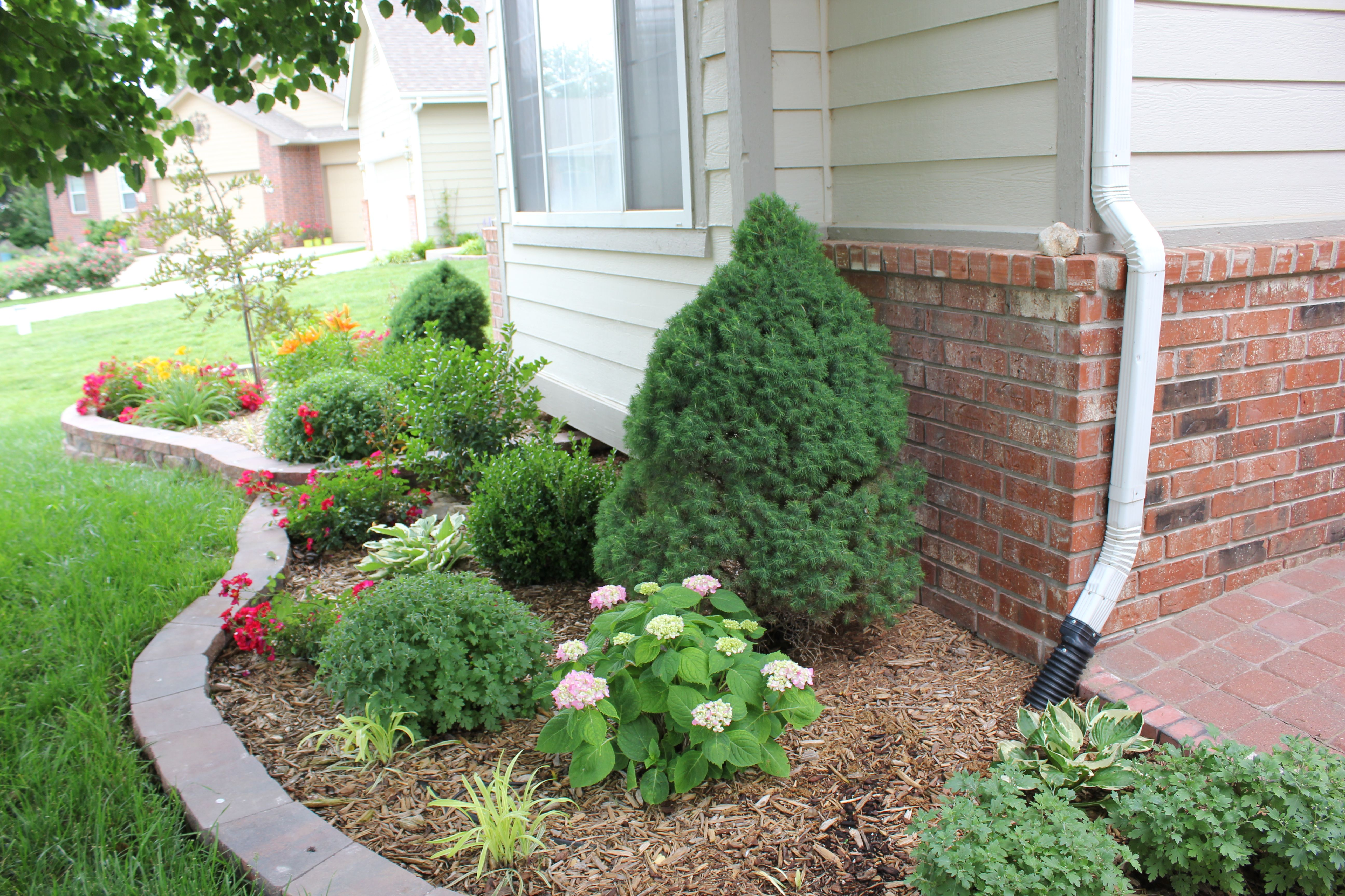 Retaining Wall Blocks From Menards : Perennial flower bed facing south st year spring
